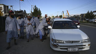 Taliban prisoners stop a local taxi after their release from Afghanistan's Bagram prison
