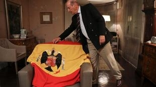 Francisco Franco, grandson of Spanish late dictator Francisco Franco, touches the original flag which draped the coffin of Franco during his burial in 1975, during an interview with Reuters at his home in Madrid, Spain, October 23, 2019.