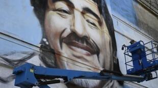 Argentine street artist Alfredo Segatori paints a mural of late Argentine football legend Diego Maradona in Buenos Aires, on December 1, 2020.