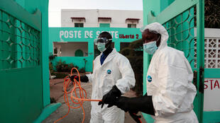 Members of local hygiene services prepare to disinfect a health centre to stop the spread of the coronavirus in Dakar, Senegal, on April 1.