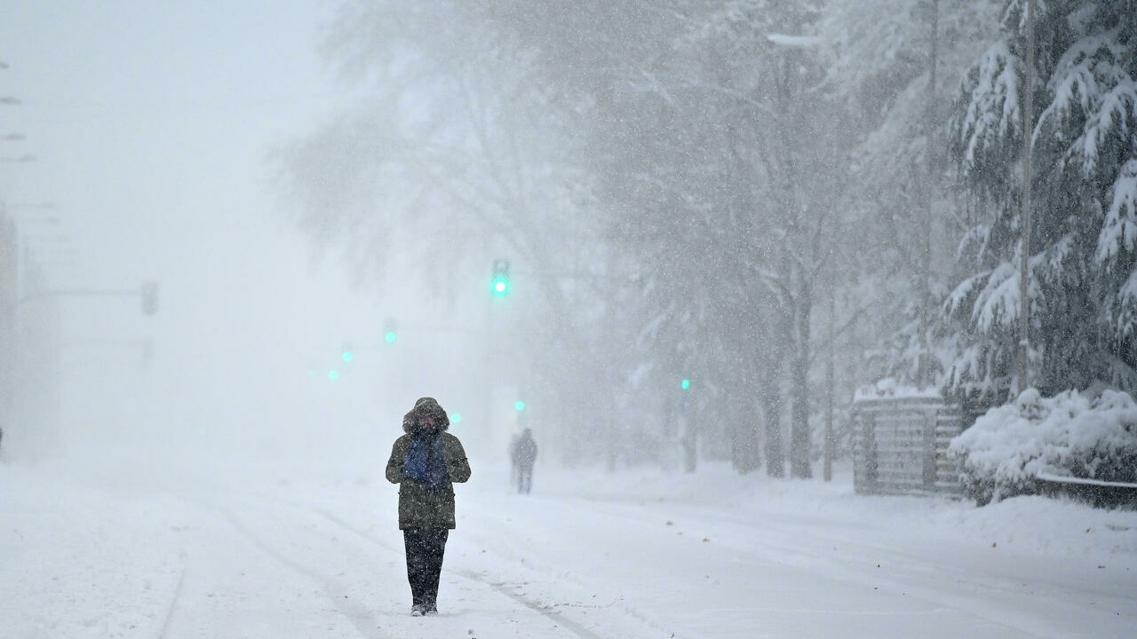 Snowstorm blankets central Spain, disrupts schools, transportation