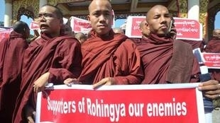 Buddhist monks protest against visiting UN Special Rapporteur on Myanmar Yanghee Lee in Rangoon.
