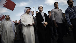 Bahrain's Al-Wefaq opposition group leader Sheikh Ali Salman (C) takes part in an anti-government protest on December 26, 2014