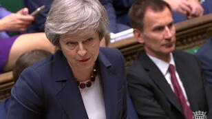 HO / PRU / AFP | A video grab from footage broadcast by the UK Parliament's Parliamentary Recording Unit (PRU) Britain's Prime Minister Theresa May as she speaks during the weekly Prime Minister's Questions (PMQs) in the House of Commons in London on January 9, 2019.
