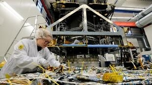 An employee works on a satellite at OHB Space Systems, a German firm that is holding its own against bigger European comptetitors