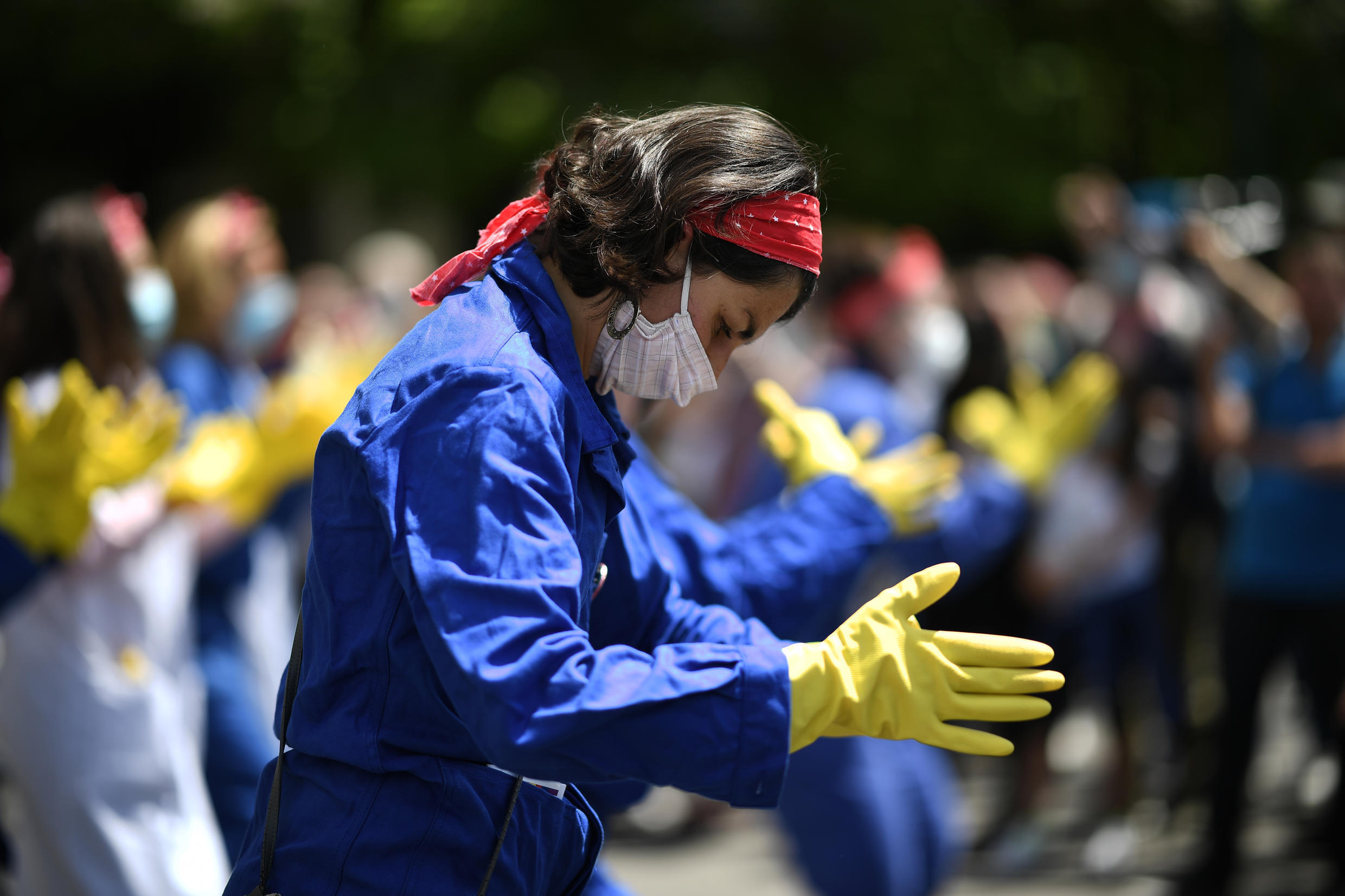 Masked protesters dressed as feminist icon Rosie the Riveter pictured in Paris on June 11, 2020.