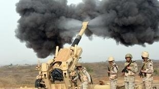 Saudi soldiers fire artillery shells towards Yemen from a post close to the border on April 13.