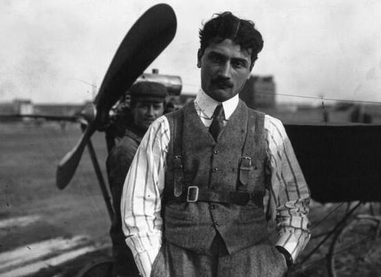 Roland Garros poses in front of a Demoiselle B.C. aircraft in 1910.