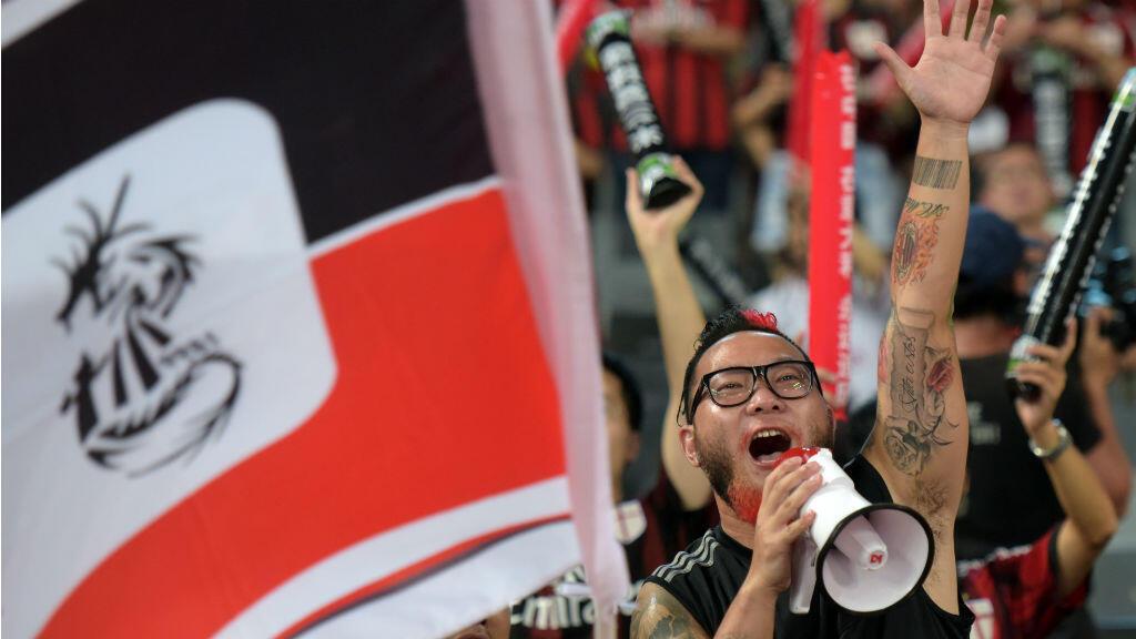 Des fans chinois de l'AC Milan lors d'un match opposant le club à l'Inter Milan à Shenzhen, le 25 juillet 2015.