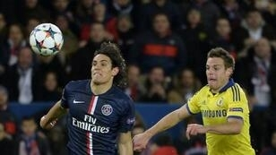 PSG's Edinson Cavani (left) challenges Chelsea's Cesar Azpilicueta during their Champions League match in Paris on February 17, 2015