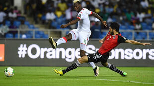 Burkina Faso star Aristide Bance (L) shoots against Egypt in a 2017 Africa Cup of Nations semi-final in Gabon