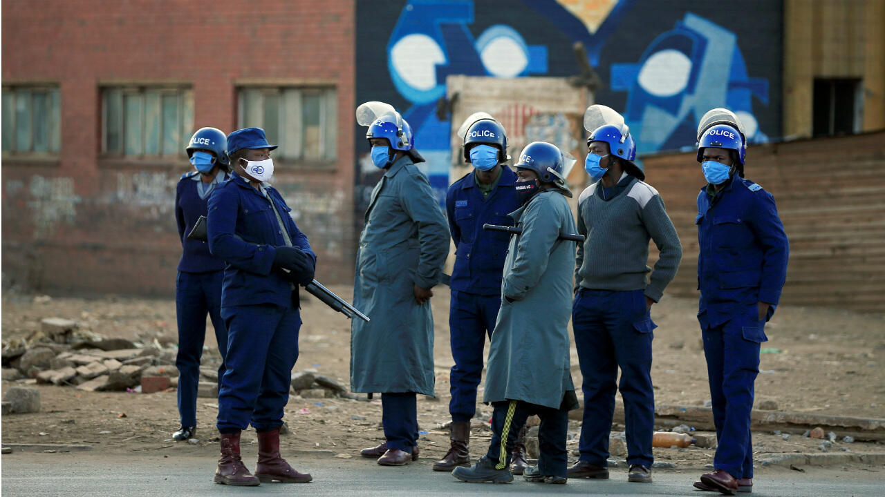 Police officers patrol the street ahead of planned anti-government protests during the coronavirus disease outbreak in Harare, Zimbabwe, on July 31, 2020.