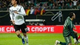 Manchester City forward Leroy Sane (L) scored Germany's opening goal in Thursday's 3-0 friendly win against Russia in Leipzig as head coach Joachim Loew named one of the youngest starting line-ups in his 12-year tenure.
