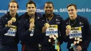 Fabien Gilot, Florent Manaudou, Mehdy Metella et Clément Mignon ont remporté l'or au relais 4x100 m, mercredi 3 décembre à Doha.