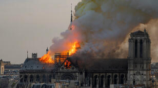 Fabien Barrau / AFP | Smoke billows as flames burn through the roof of the Notre-Dame de Paris Cathedral on April 15, 2019, in the French capital Paris.