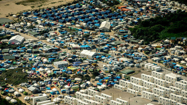 "This picture taken on August 16, 2016, shows an aerial view of the sprawling ""Jungle"" migrant camp in the northern French port city of Calais."