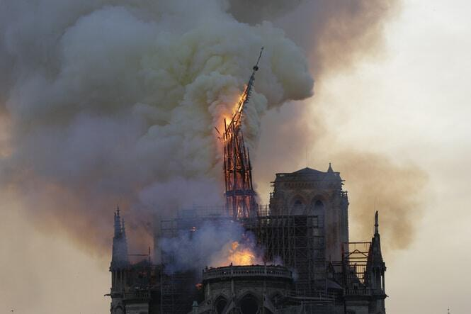 The moment the cathedral's 19th-century spire collapsed. AFP