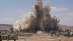 An image made available by Jihadist media outlet Welayat Homs on May 30, 2015, allegedly shows the Tadmur prison in the Syrian city of Palmyra being blown up by Islamic State group jihadists