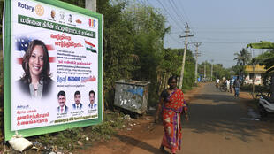 A poster bears the image of Kamala Harris in her ancestral village of Thulasendrapuram