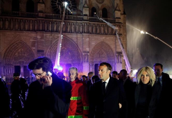 French President Emmanuel Macron arrives at the scene. Macron vowed the cathedral would be rebuilt. AFP