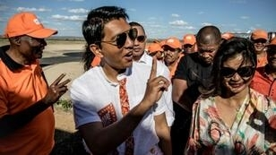Madagascar presidential candidate Andry Rajoelina (C) is the frontrunner in the November 7 ballot, according to preliminary results