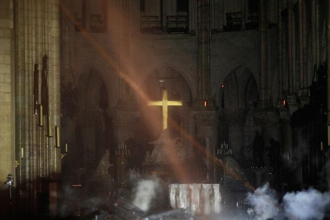 Smoke surrounds the cross of Notre-Dame's altar. AFP