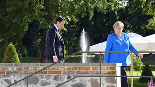 On the same side of the fence: Conte and Merkel at the German governmental guest house in Meseberg, outside Berlin, on Monday