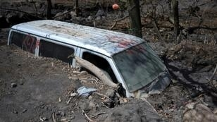 A van buried by ash from Guatemala's Fuego volcano in the village of San Miguel Los Lotes, which was wiped off the map in the eruption which killed 202 people and left 229 missing