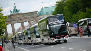 Tourism industry workers demonstrate with a bus parade demanding financial help from the German government in Berlin, Germany, on May 13, 2020.
