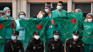 Healthcare workers confort the wife of Esteban, a male nurse that died of Covid-19 at the Severo Ochoa Hospital in Leganes, near Madrid, Spain on April 10, 2020.