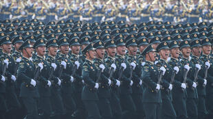 Chinese troops march in October 2019 in Tiananmen Square in Beijing at a time of growing friction with the United States