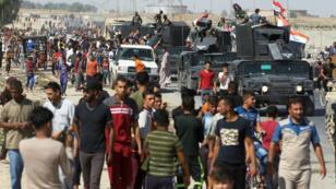 القوات العراقية تدخل أحد الأحياء الجنوبية لمدينة كركوك 16 تشرين الأول/أكتوبر 2017.