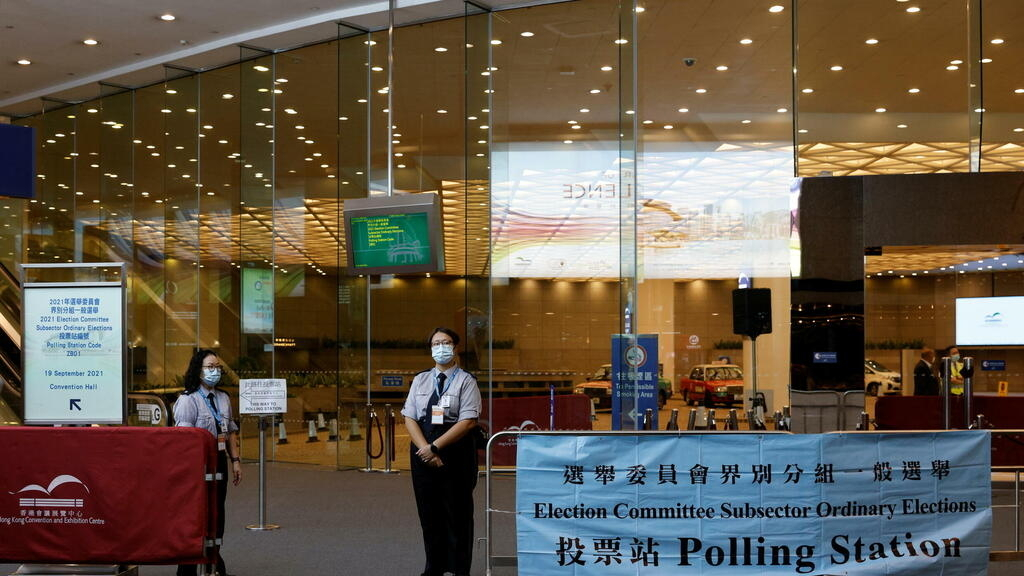 Select Hong Kong residents vote in election designed so that 'only patriots' prevail