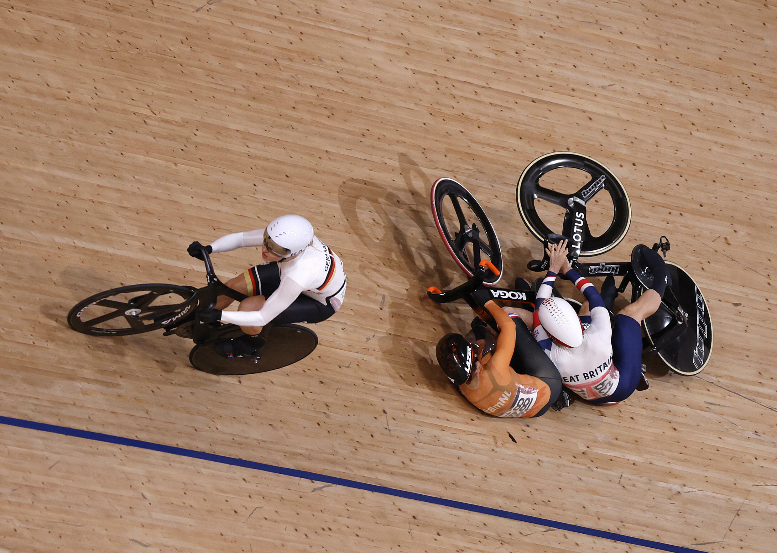Accidents, such as the one between Dutch Laurine van Riessen (C) and Briton Katy Marchant at the Olympics, are common in Keirin