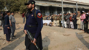 Pakistani mourners near the school in Peshawar that was attacked by Taliban militants