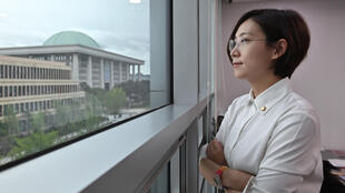 Jang Hye-yeong looks out of her office window towards South Korea's legislature, which she called 'an institution made up of middle-aged, able-bodied men'
