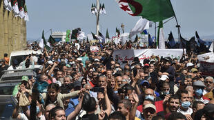 Algerians shout slogans during an anti-government demonstration in the capital Algiers on May 7, 2021