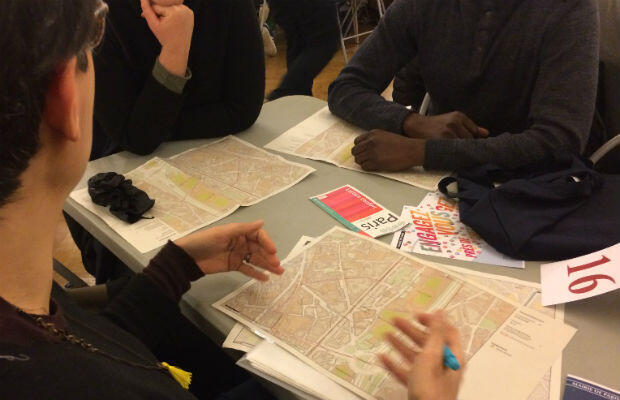 Volunteers receive their maps at 20th arrondissement town hall in eastern Paris.