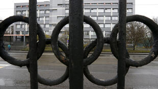A view through a fence decorated with the Olympic rings shows a building that housed a laboratory accredited by the World Anti-Doping Agency (WADA). On Monday, December 9, 2019, the agency banned the Russian flag and national anthem from the Olympics and other world sporting events for four years.
