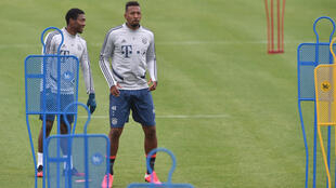 Bayern Munich defenders David Alaba (L) and Jerome Boateng in training last week