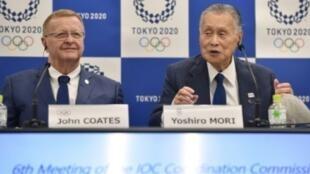 مؤتمر صحافي مشترك بين جون كواتيس (اللجنة الأولمبية الدولية) ومدير ألعاب طوكيو الأولمبية يوشيرو موري بعد جلسة عمل في 12 أيلول/سبتمبر 2018