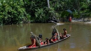 From Amazon rainforests to the Arctic Circle, indigenous peoples are under siege. Waiapi people cross the Feliz river by barge in Amapa state, Brazil