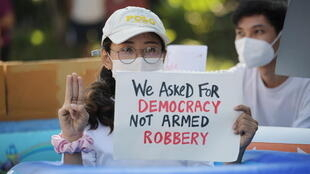 People protest against the military coup and to demand the release of elected leader Aung San Suu Kyi, outside the Japanese Embassy in Yangon, Myanmar, February 10, 2021.