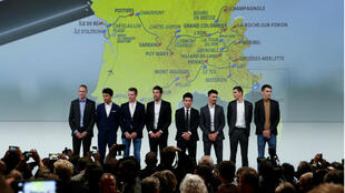Cyclists Christopher Froome, Egan Bernal, Steven Kruijswijk, Thibaut Pinot, Caleb Ewan, Julian Alaphilippe, Warren Barguil and Romain Bardet pose in front of the map of the 2020 Tour de France cycling race after a news conference in Paris, France, on October 15, 2019.