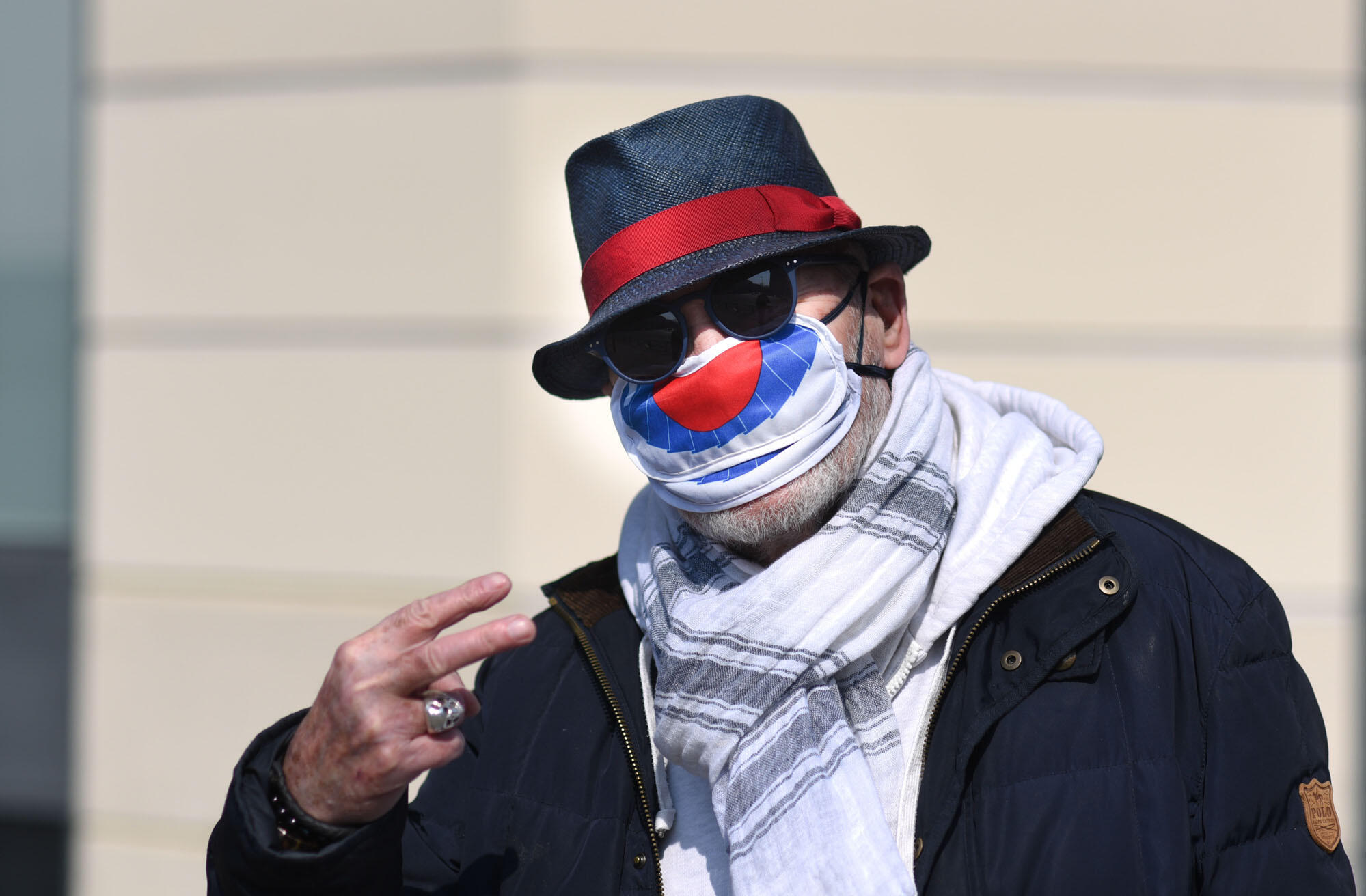 Despite the lockdown, Parisians try to keep their spirits up. This man wears a protective mask that looks like a clown mask.