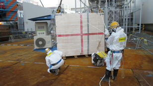 Technicians at work at the Fukushima nuclear power plant on February 9, 2015