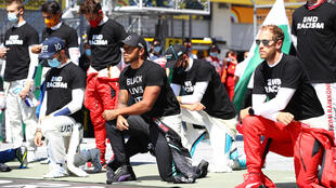 Take a knee: Lewis Hamilton makes a protest along with other drivers at the Austrian Grand Prix
