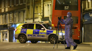 A police forensics officer at work on Streatham High Road in south London on February 2, 2020.