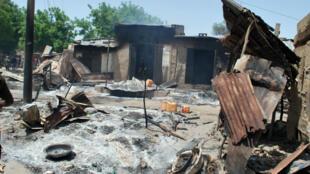 Houses burnt by Boko Haram fighters near Maiduguri, in northeast Nigeria, on July 4, 2015