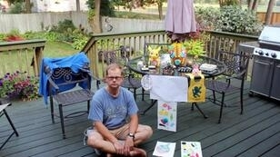 American James Cook with paintings and toys belonging to his child at his mother's house in Crystal city, Minnesota -- one of a number of foreign fathers battling Japan's legal system for access to their children after divorce